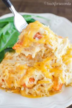 "<p>Easy Cheesy Crockpot Chicken is a no fuss dinner that everyone loves! Hearty, creamy and cheesy- even picky eaters like it! Great meal for busy weeknights! Recipe <a href=""https://backforseconds.com/easy-cheesy-crockpot-chicken/""><strong>HERE.</strong></a></p>"