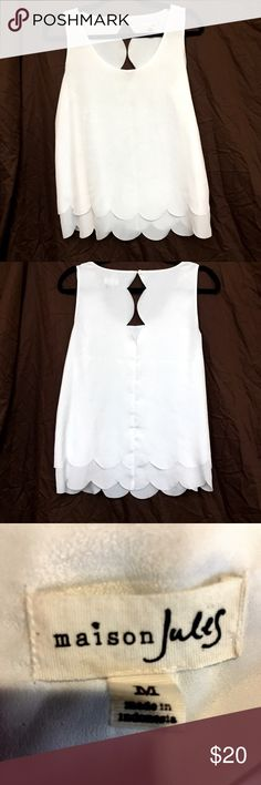 "Maison Jules White Scalloped Blouse White scalloped sleeveless blouse by Maison Jules. The fabric feels soft and silky. It has never been worn before and is in excellent condition. It's 24"" long and the bust is 39"". 100% polyester and there is no stretch. Maison Jules Tops Tank Tops"