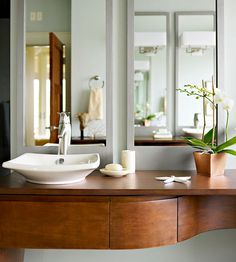 This curved vanity adds traditional elegance to this space. More bathroom vanity ideas: http://www.bhg.com/bathroom/vanities/bathroom-vanity-ideas/?socsrc=bhgpin080313curvedvanity