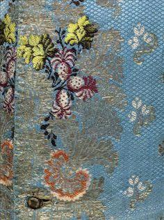 Waistcoat (detail front), France, c. 1750. Blue silk, brocaded liseré Gros de Tours in polychrome silk thread, silver thread.