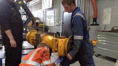 Gary @Ainscough and Jake from L&W Wilson Ltd working on a @JCBExcavator1 axle #madebyapprentices @MyerscoughColl