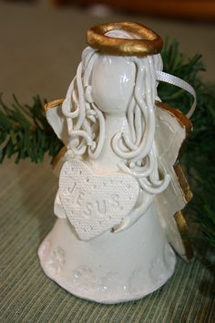 clay angel ornament. Use a few of the aspects of this angel on my angels. I can use this kind of halo too, and less hair than I've normally used.
