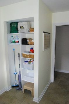 In a utility room, create an organized storage nook by skipping a door and installing floor-to-ceiling shelving. Keep the look neat with baskets, bags and containers.