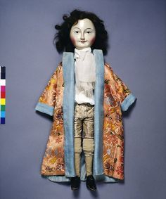 """Lord Clapham"", Fashion Doll, 1690-1700, wearing silk kimono style undress gown over shirt and breeches. The doll is a costume documents, clothes being, in style, cut and material, perfect miniatures of the fashions of the late 17th century. Their importance is underlined by the almost total lack of other good visual material for this period, whether pictorial or in the form of surviving garments. VA Collections"