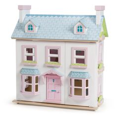Mayberry Manor: this deluxe, 3 storey, wooden Le Toy Van doll's house is packed with charming details. The reversible rear roof panel doubles as a beautiful front garden, with a little path that leads up to the front door.   £129.00 from www.moosterbaby.co.uk   #woodentoys