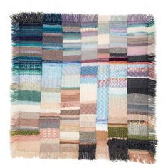Vogue Knitting Holiday 2015  Design by Sonja Biedermann Afghan worked in separate strips using multiple yarns, colors and stitch patterns, then sewn together.