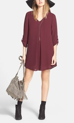 A burgundy shift dress, styled with a felt floppy hat, a fringe purse and ankle booties makes for the perfect summer-to-fall transitional outfit.
