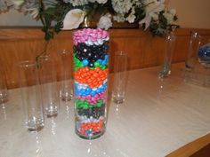 Wedding Unity M and Ms ceremony yesterday at Foothills Wedding Chapel and Banquet Room! Ive never seen this at our wedding venue. How creative can you get? Five kids, two parents, blended family, each kid (and the parents) got one color of M and Ms and they poured it all together like in a Unity Sand Ceremony! Yes the kids were allowed to eat their Unity M and Ms. No ordinary Unity Candle ceremony this. wedding-ideas