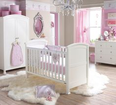 pink and grey nursery...don't love the wallpaper border..but LOVE the rug! :)