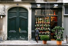 Flower shop with wonderful architecture and window display via cameraman.