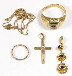 Lot 229: 14k and 10k Gold Jewelry Assortment; Five items including one 14k ring, 14k pendant, 10k cross, 10k child ring and 10k necklace; all have stamped karat marks; and a Landstom's  brochure