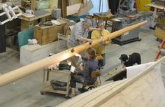 The first coat to seal Friendship Sloop Momentum's new mast went on today, with Spirit supervising.