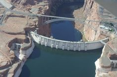 Hoover Dam is located at the southern end of Lake Mead at the   Nevada-Arizona border.  Hoover Dam is about 30 miles southeast of Las Vegas.