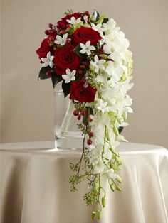 96 best red white and black wedding flowers images on pinterest in presentation perfect for the bride that likes to hold everyones attention white dendrobium orchids cascade from a compact bouquet of red roses mightylinksfo