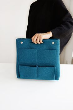 The *Long Felt Purse Organizer* is a super functional and classy organizer! It is designed to help tidy up bags and purses and is ideal for use in larger tote bags. It features 8 pockets on the outside and 9 additional pockets inside. The bottom Purse Organization, Organizing, Felt Purse, Large Tote, Homemade Gifts, Travel Bags, Everyday Fashion, Crafty, Purses