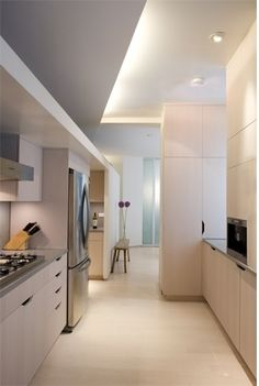 Like the blue-grey ceiling paint. Breaks up an all-white kitchen. Then again it may be off-white but in the picture it looks like color.