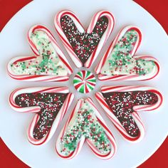 Kids would like doing this. Fill mini candy canes, shaped together to form a heart, with melted white or dark chocolate. Add sprinkles.