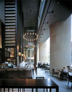 Looking along the George Street edge of Glass Brasserie, with the large feature wine rack by Tony Chi.Image: Richardson Glover