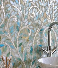 Climbing Vines, a jewel glass waterjet mosaic, is shown in Aquamarine leaves and Quartz vines. New Ravenna Mosaics 2010 Beadboard Backsplash, Mosaic Backsplash, Herringbone Backsplash, Mosaic Tiles, Backsplash Ideas, Grey Backsplash, Tiling, Mirror Backsplash, Fireplace Backsplash