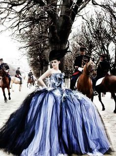 kristen stewart - Mario Testino. I may not like Kristen Stewart but holy shit is this shot ever stunning. The horsemen, the gown everything just is amazing, Testino is an absolute master