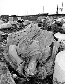 "famous photograph by Eddie Hausner of the ruined sculpture ""Day"" by Adolph Alexander Weinman in a landfill of the New Jersey Meadowlands from the original penn station"