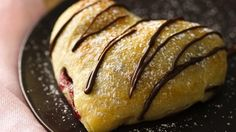 Flaky Crescents wrap around a chocolate-hazelnut filling in a love-ly heart-shaped dessert.