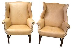 Pair of Antique Wingback Chairs; New Raw Leather Upholstery