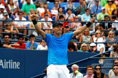 Tennis - 2012 US Open - Tomas Berdych (CZE)[6] raises his arms in triumph after he defeated Nicolas Almagro (ESP)[11] 7-6(4), 6-4, 6-1 in the fourth round. - Philip Hall/USTA