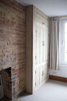 lovely built in rustic wardrobe made from reclaimed wood. And I love bricks like this in an interi. Alcove Wardrobe, Wardrobe Doors, Bedroom Wardrobe, Wardrobe Closet, Wardrobe Ideas, Wardrobe Design, Closet Ideas, Master Bedroom, Alcove Cupboards