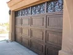 A classy yet beautiful look for any garage door. Is it time to upgrade your garage? Garage Door Colors, Garage Door Styles, Garage Door Design, Modern Garage Doors, Carriage Garage Doors, Iron Decor, Home Projects, House Plans, Sweet Home
