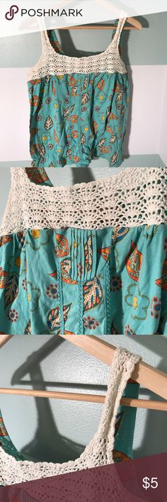 Knit patterned tank top in size Large  Decree tank top in size Juniors Large. Worn but no flaws, kept in good condition. The straps are a knit pattern which adds great detail to the shirt. 60% cotton, 40% polyester. From a smoke free home. Decree Tops Tank Tops