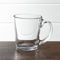Shop Tempo Clear Glass Coffee Mug. Simply styled clear glass mugs work equally well with either of our clear glass dinnerware collections: square-shaped Tempo or round Moderno.