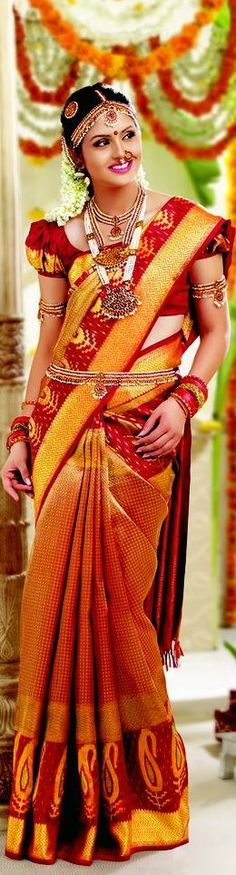 Traditional Indian bride wearing brocade bridal silk sari and jewellery