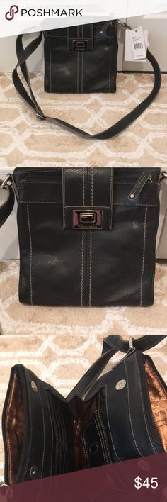 NWT Tignanello leather cross-body bag Black leather with tan stitching with magnet clasps. Two large zipper pockets, two smaller zipper pockets and middle interior storage. Plenty of room for cell phone, makeup bag, cash and cards and lots of little odds and ends. Make me an offer before I decide to keep for myself! Tignanello Bags Crossbody Bags