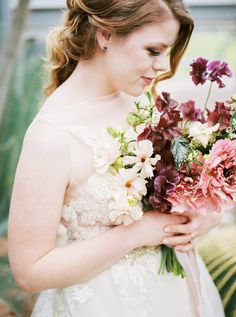 Floral by Color Theory Collective | Romantic, Southwest styled wedding | Plum, Champagne, Marsala, Ivory, Blush, Mauve | Sweet peas, Ranunculus, Garden Roses, Japanese Charlotte Ranunculus, natural greenery with trailing silk by Seda Medecina | Photograph by Feather & Twine | Venue- The Greenhouse at Driftwood | Austin, TX Wedding