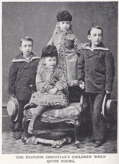 The children of Princess Helena and Prince Christian of Schleswig-Holstein when quite young. Princess Helena Victoria (seated) and Princess Marie Louise (standing) with their two brothers