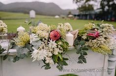 Native flowers in a country setting are the perfect compliment to a rustic mantle for the ceremony back drop #native flowers