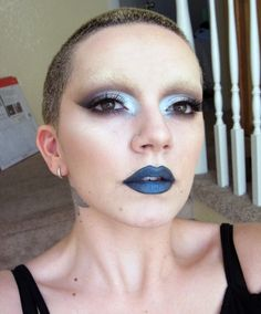 blocked brows, taupe winged crease, silver blue eyelid and inner corner, dark turquoise lips