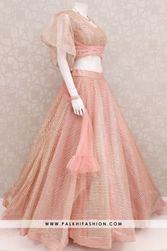 Palkhi fashion exclusive full flair light peach designer hand worked soft net lehenga with stylis blouse.One side bell sleeve & spaghetti pattern Party Wear Indian Dresses, Indian Fashion Dresses, Designer Party Wear Dresses, Indian Bridal Outfits, Indian Gowns Dresses, Dress Indian Style, Indian Designer Outfits, Net Dresses, Wedding Dresses For Girls