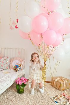 pink balloons with gold ribbons! I want this for my next birthday! lol