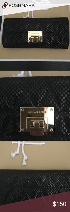 Michael Kors wallet Beautiful Vivienne wallet in embossed leather . Many compartments inside , one on the outside . Great gift for the holidays . Brand new with tag . Comes with MK shopping bag . Michael Kors Bags Wallets