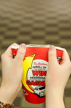 The BEST and EASIEST way to Roll Up The Rim To Win!!  Squish the cup and roll up the rim with your thumbs.  Sooo easy! Gnawing on the cup is one of my biggest pet peeves..