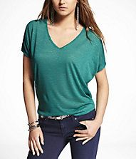 Express double v-neck wedge tee. I have this shirt in every color! Tomato orange, neon berry, liquid gray, and jewel green.