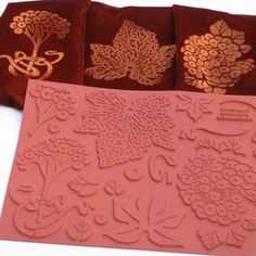 How to iron rubber stamp designs onto velvet: lay rubber stamp image side up on table. Lay velvet sheet/scarf velvet side down over the stamp. Spray mist the back of your velvet, then iron on wool setting. Should only take a few seconds, taking care not to move the velvet around while it is picking up the stamped impression.