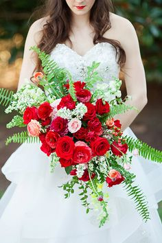 Lush red bridal bouquet with carnations, roses, and ranunculus | Kendall Lynnette Photography & Design | see more on: http://burnettsboards.com/2014/06/disney-beauty-beast-wedding/