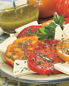 Tomatoes Dressed with Pesto Vinaigrette. Recipe here http://www.vegetablegardener.com/item/3594/tomatoes-dressed-with-pesto-vinaigrette#