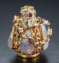 Diamonds and Rhubarb ® Scent bottle, gold, Hungarian opals, rubies , pink sapphires, diamonds, and enamel.