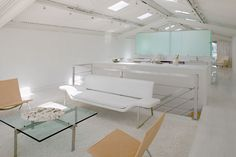 Two rows of skylights march through the space, emphasising the depth