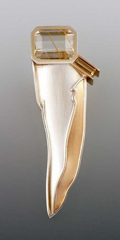 """Crevasse"" brooch by Eleanor Moty, 1993. Sterling silver, 18K gold, 14K gold, limonited topaz, topaz"