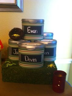 "Camping Birthday Party - Party Favors/""Survival Kits"" made from Enfamil containers.  The kids LOVED them!"